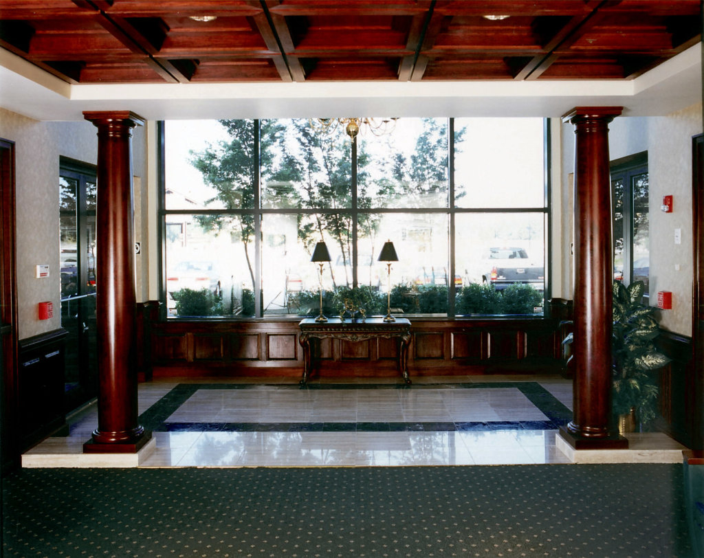 Stained Smooth Wood Columns in Breezeway