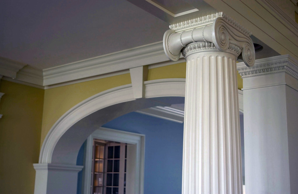 An Ionic Capital atop a Fluted PolyStone® Column in Chadsworth Cottage