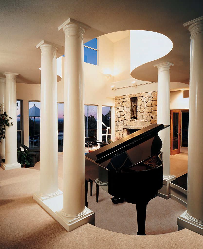 Tuscan Columns around a Piano in a Living Room