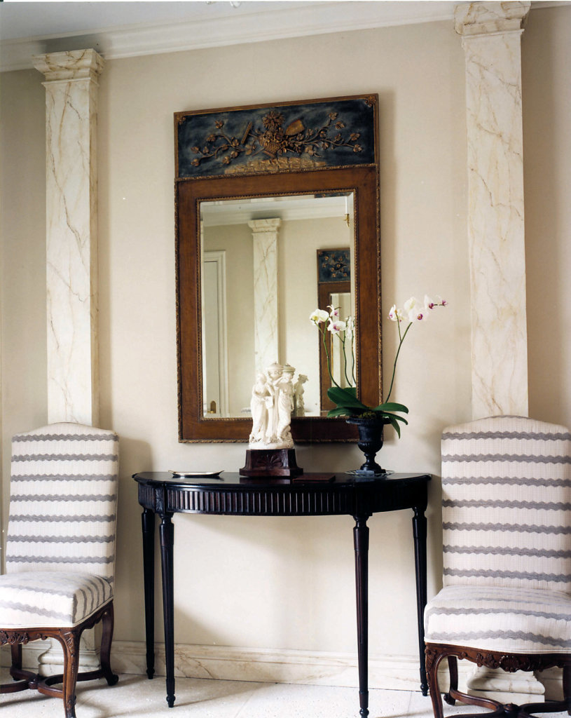 Faux Marble Square Pilasters in a Hallway
