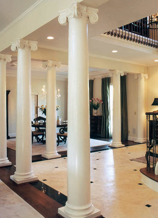 White Scamozzi Columns Near Staircase